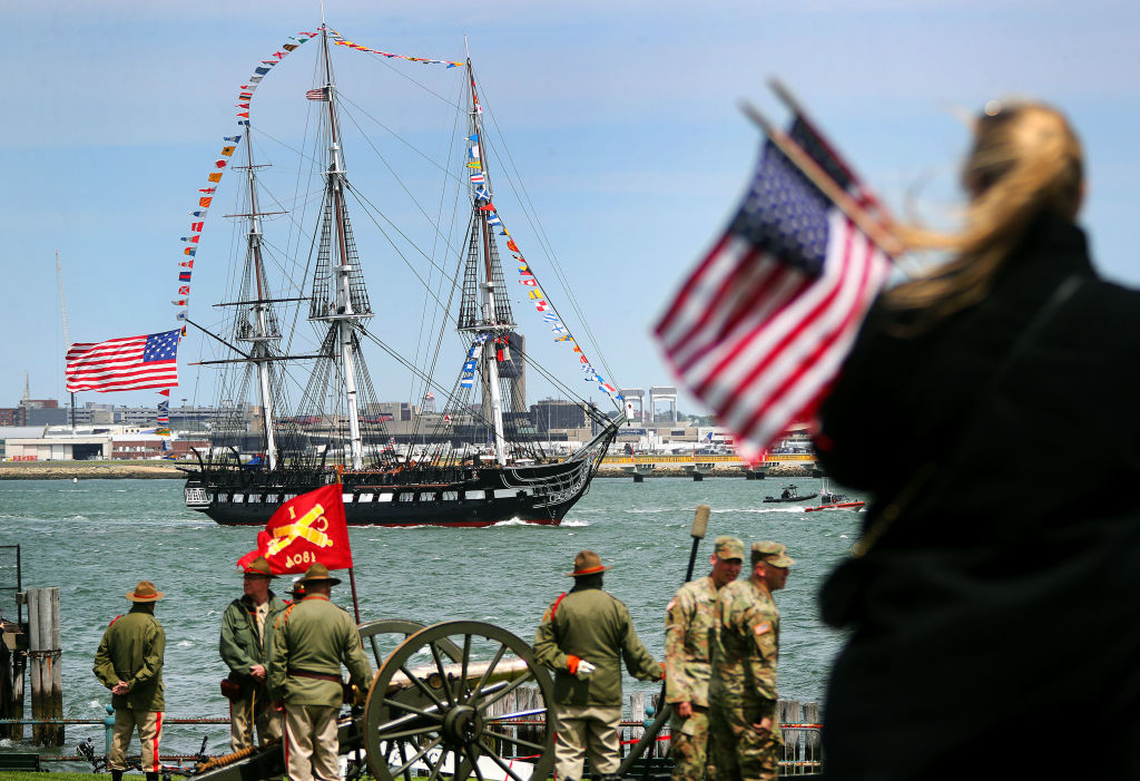 The USS Constitution is surrounded by international flags.