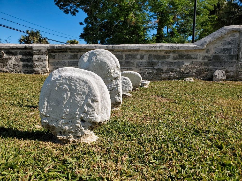graveyard headstones that are worn away at the bottom