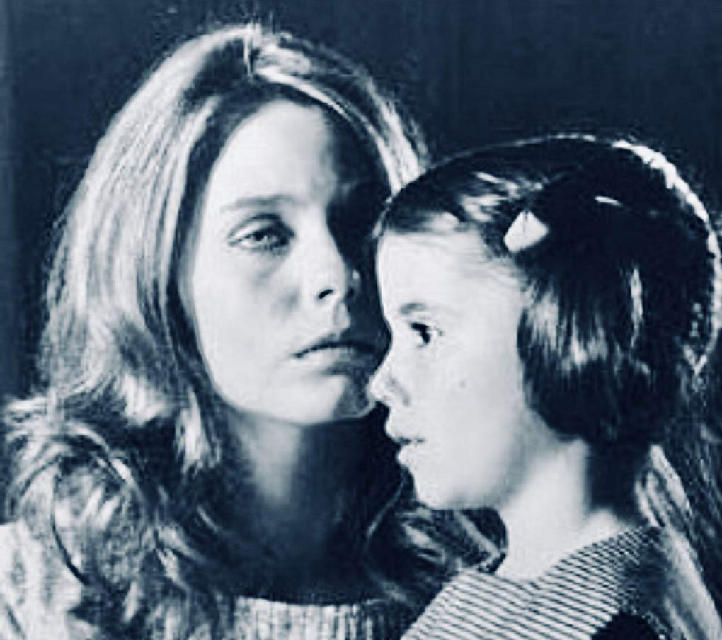 Susan Dey whispers to a child in the movie Mary Jane Harper Cried Last Night.