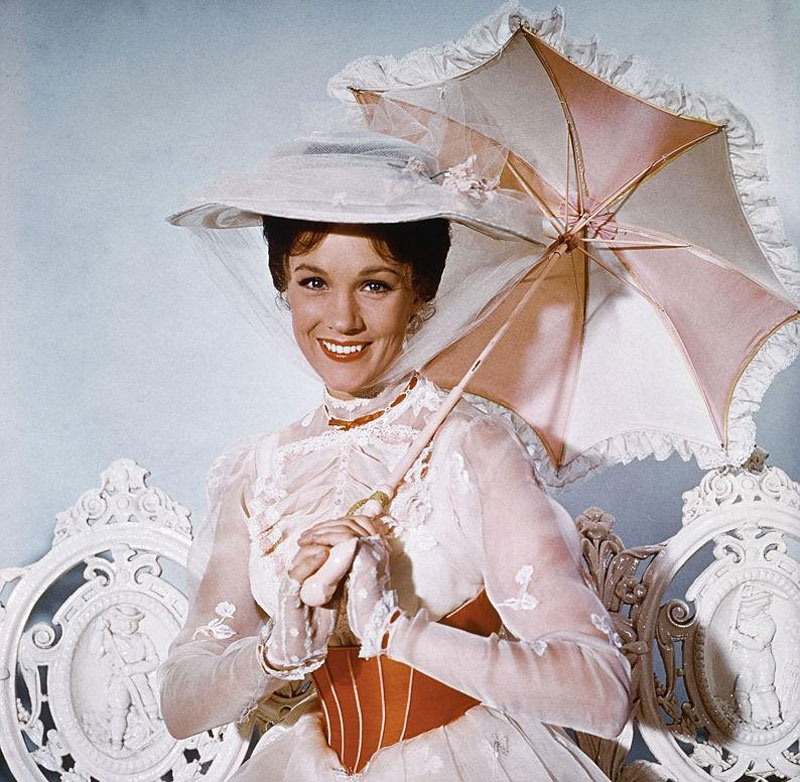 Julie Andrews poses with an umbrella as Mary Poppins.