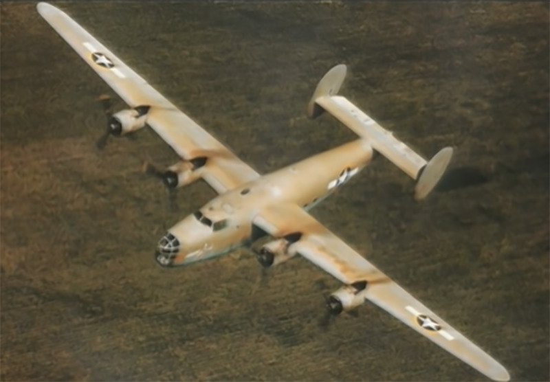 A B-24D plane is pictured flying.