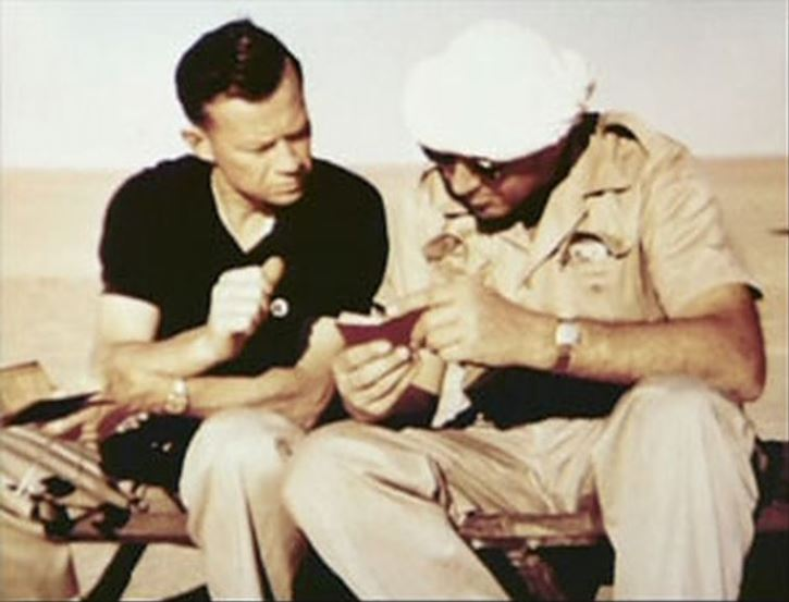 Two men examine Lieutenant Toner's diary shortly after discovery.