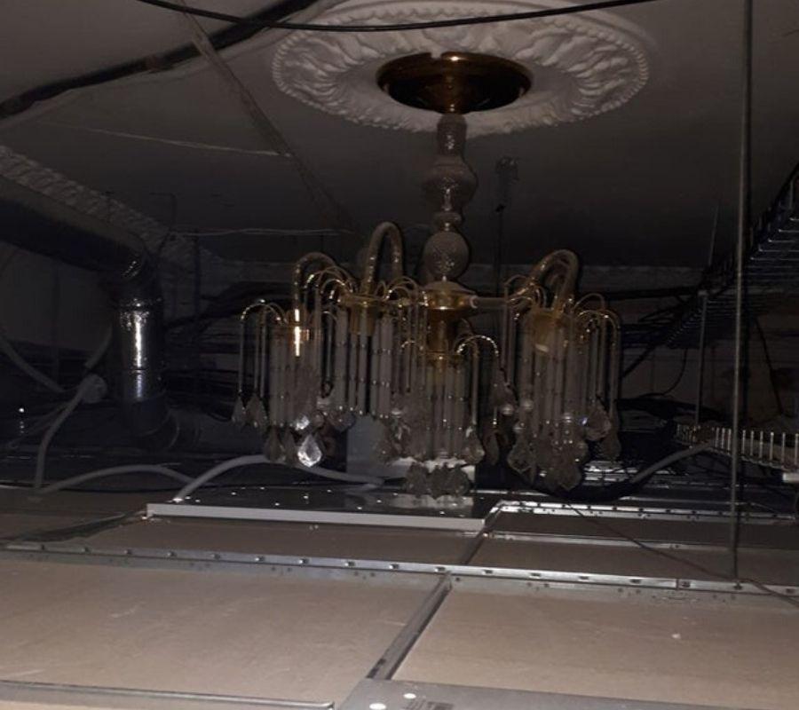a drop ceiling put over a chandelier