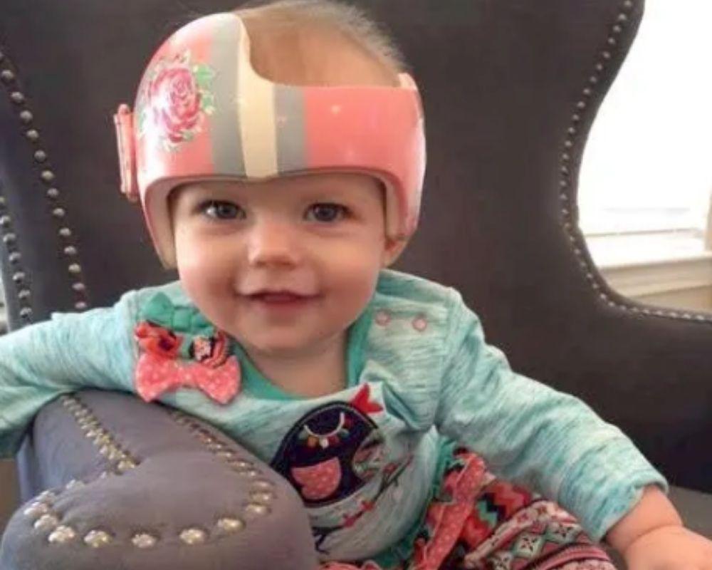 Baby girl in pink helmet