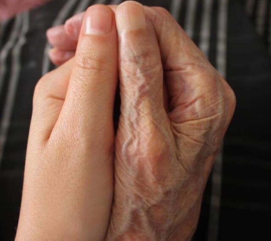 an older hand and younger hand