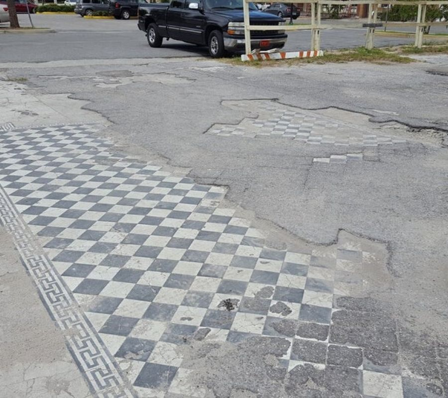 a parking lot that was paved where a building used to be