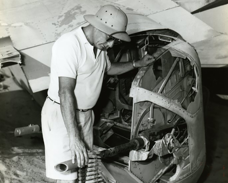 A search party member examines the guns of the Lady Be Good B-24D bomber.
