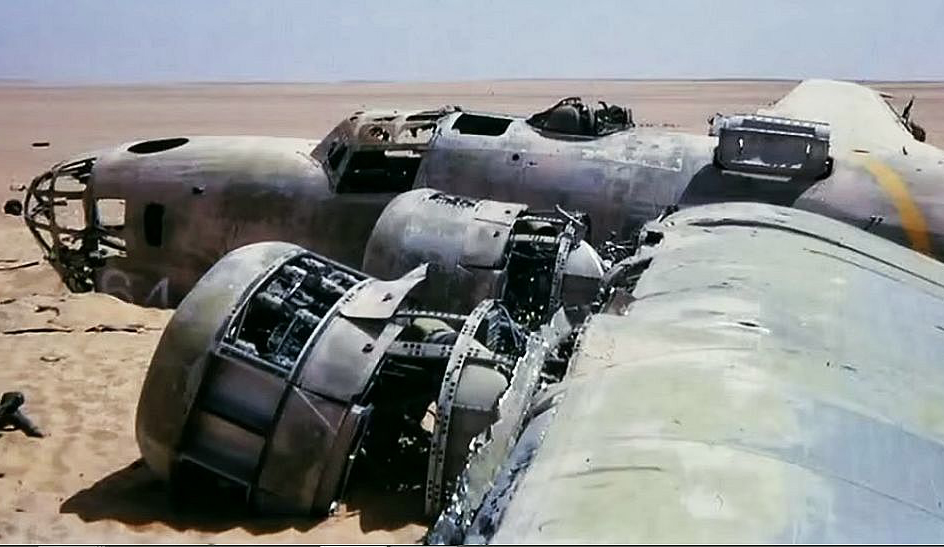 A colored photo displays the Lady Be Gone B-24D in the Libyan desert.