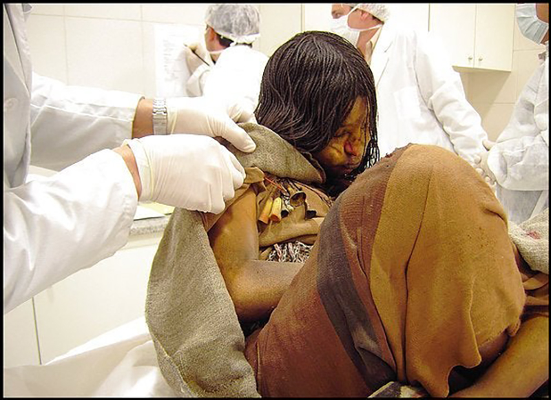 Researchers examine a 500-year-old preserved girl named Juanita.