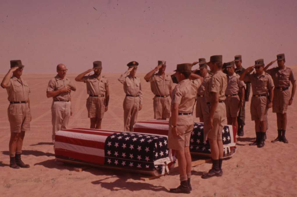 Soldiers salute the dead crew of Lady Be Good.