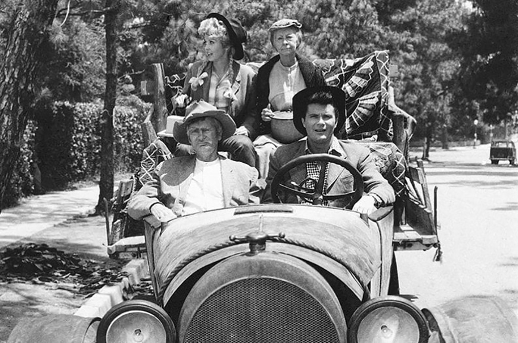 Cast of the show riding in a car