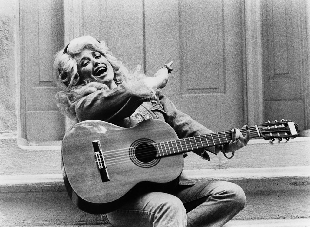 Photo of Dolly Parton with guitar