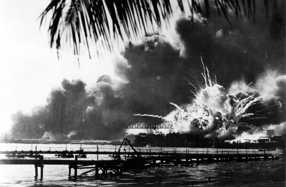 The American destroyer USS Shaw explodes during the Japanese attack on Pearl Harbour.