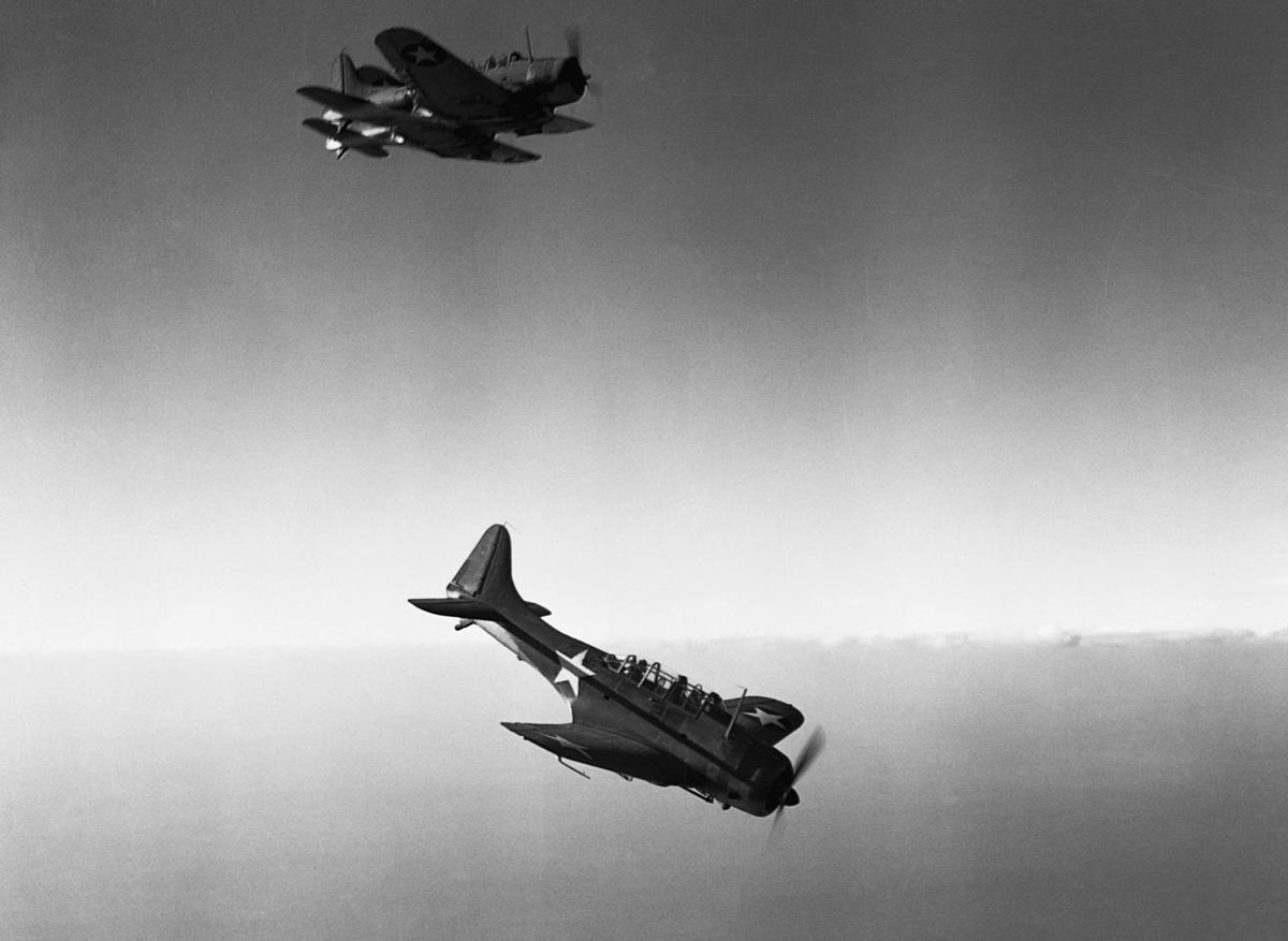 Douglas SBD Dauntless dive bombers fly above the Naval Air Station at Daytona Beach, Florida, 1942.
