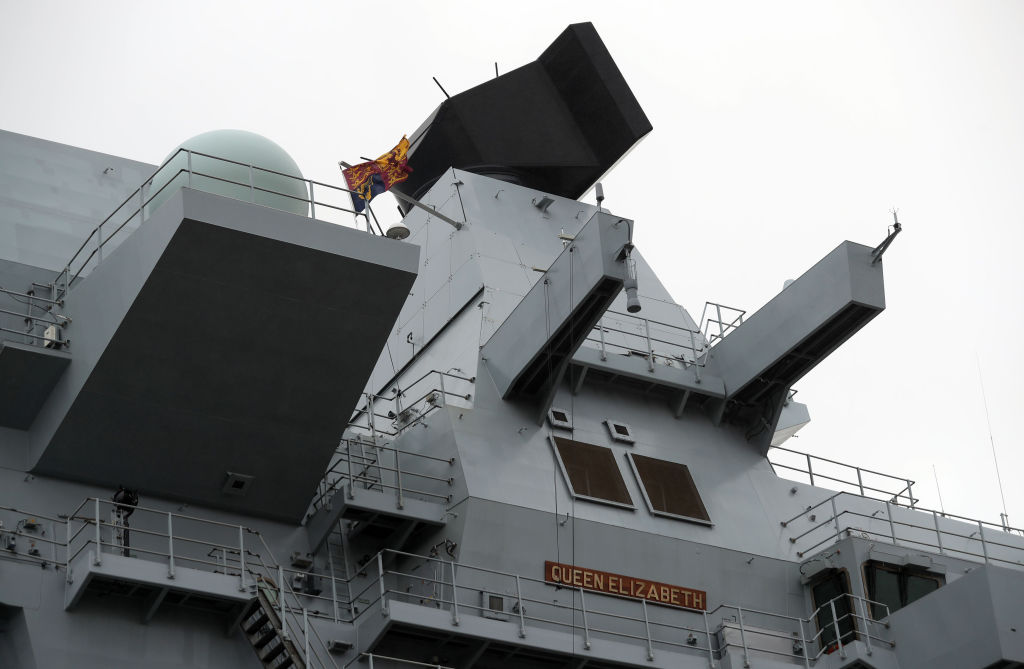 The Royal Standard flag flies above the forward tower on HMS Queen Elizabeth after her commissioning ceremony