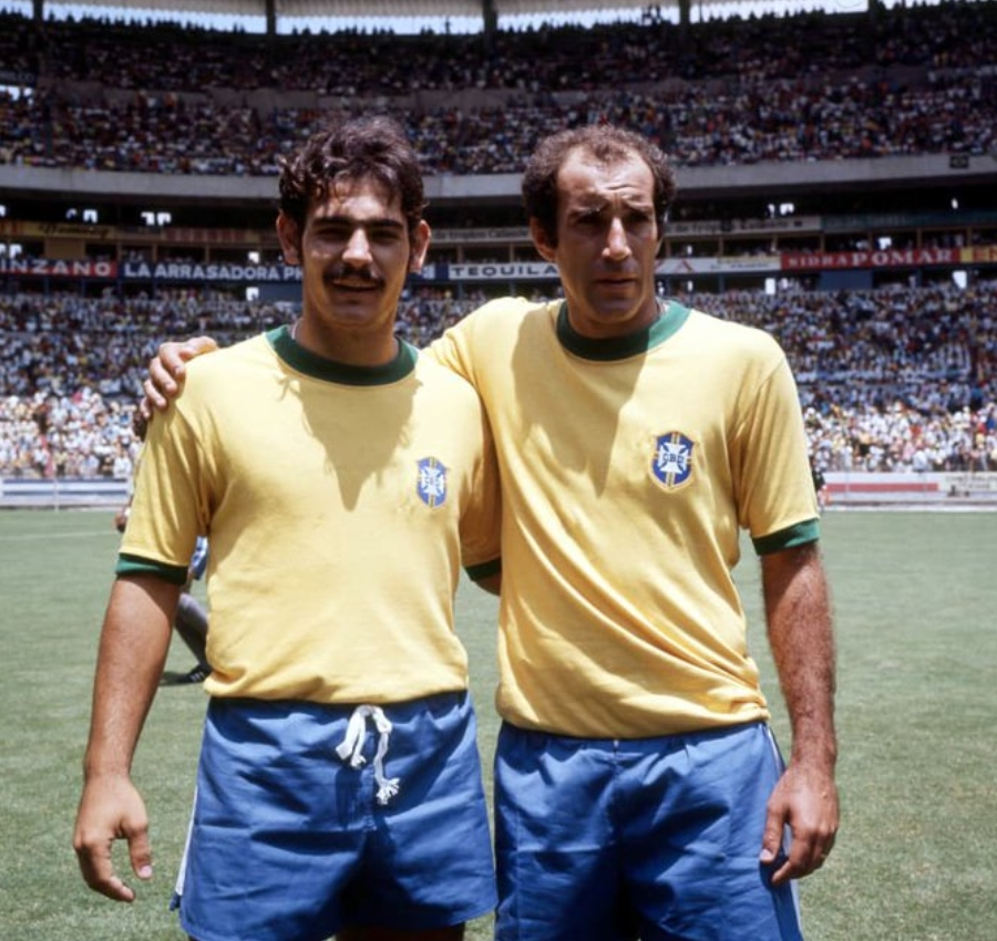 two brazillian soccer players standing in field