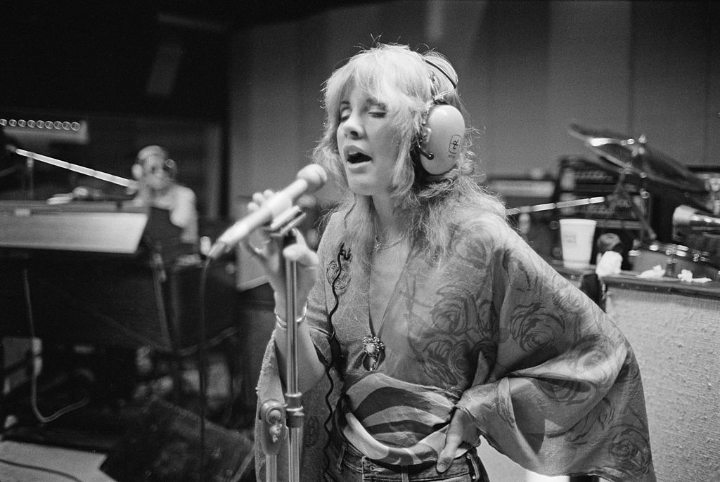 Stevie Nicks sings in a recording studio.