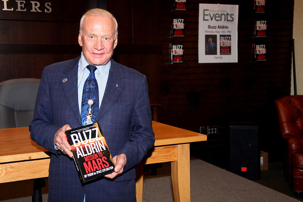 Buzz Aldrin with his book