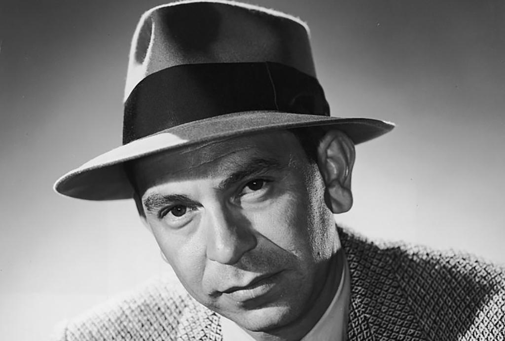 Jack Webb wearing a hat