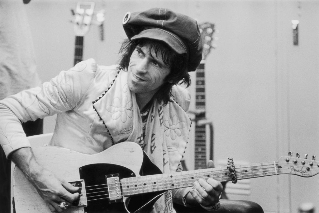 Keith Richards plays guitar backstage.