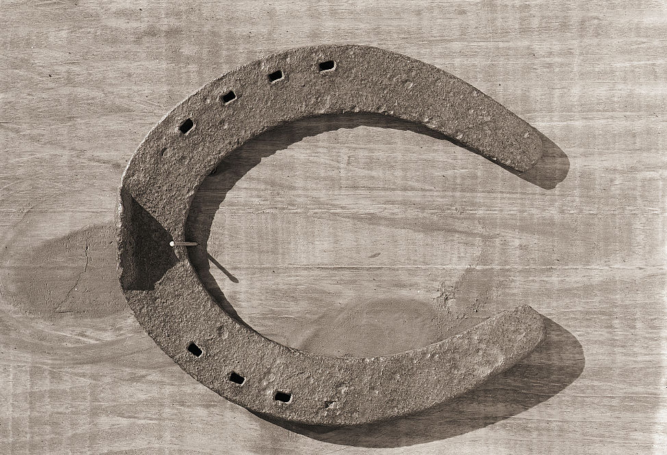 Horseshoe nailed to wall