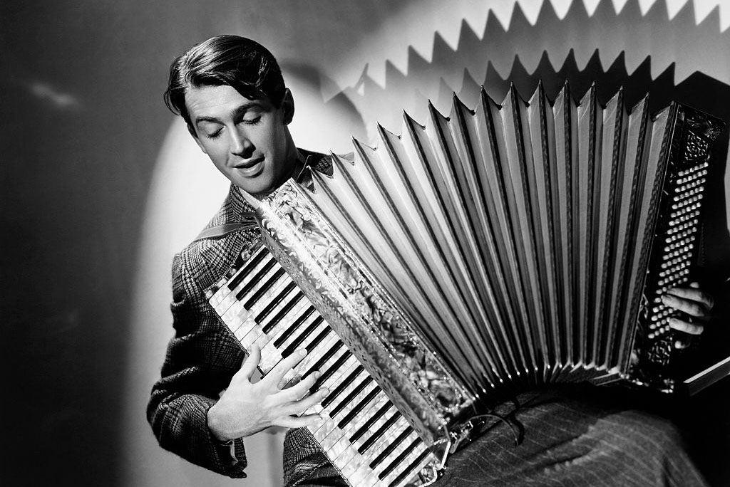 Stewart playing the accordion
