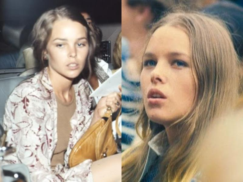 Michelle Phillips wears a straight face while in a crowd.