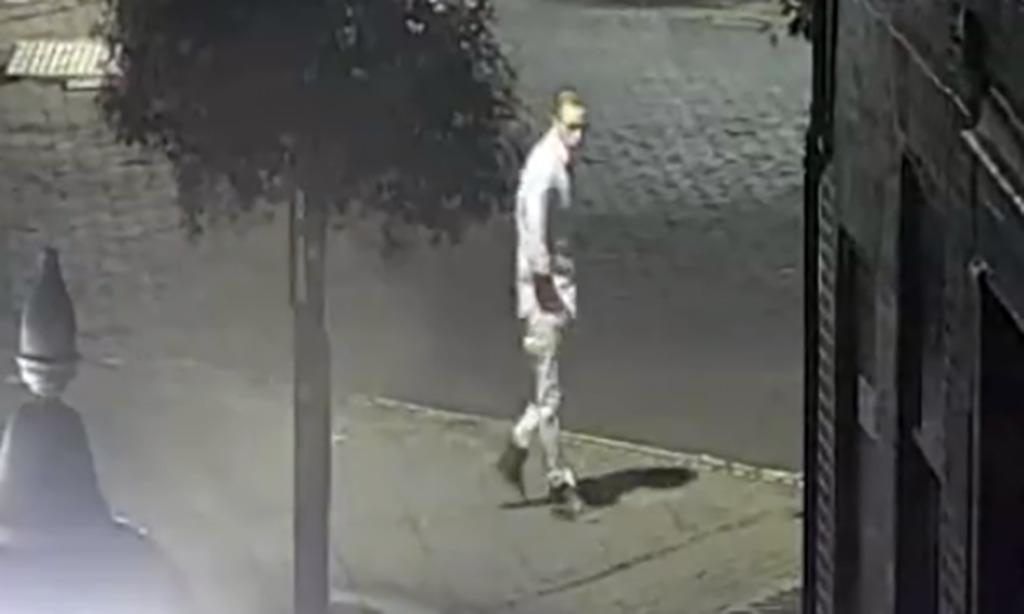 Footage of Corrie walking toward the horseshoe