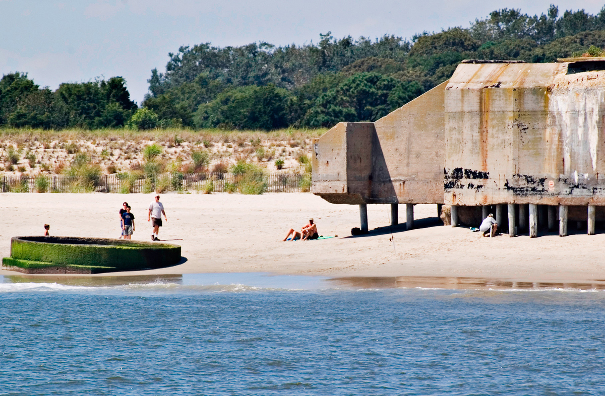 Beach-goers explore the bunker at Cape May, New Jersey.