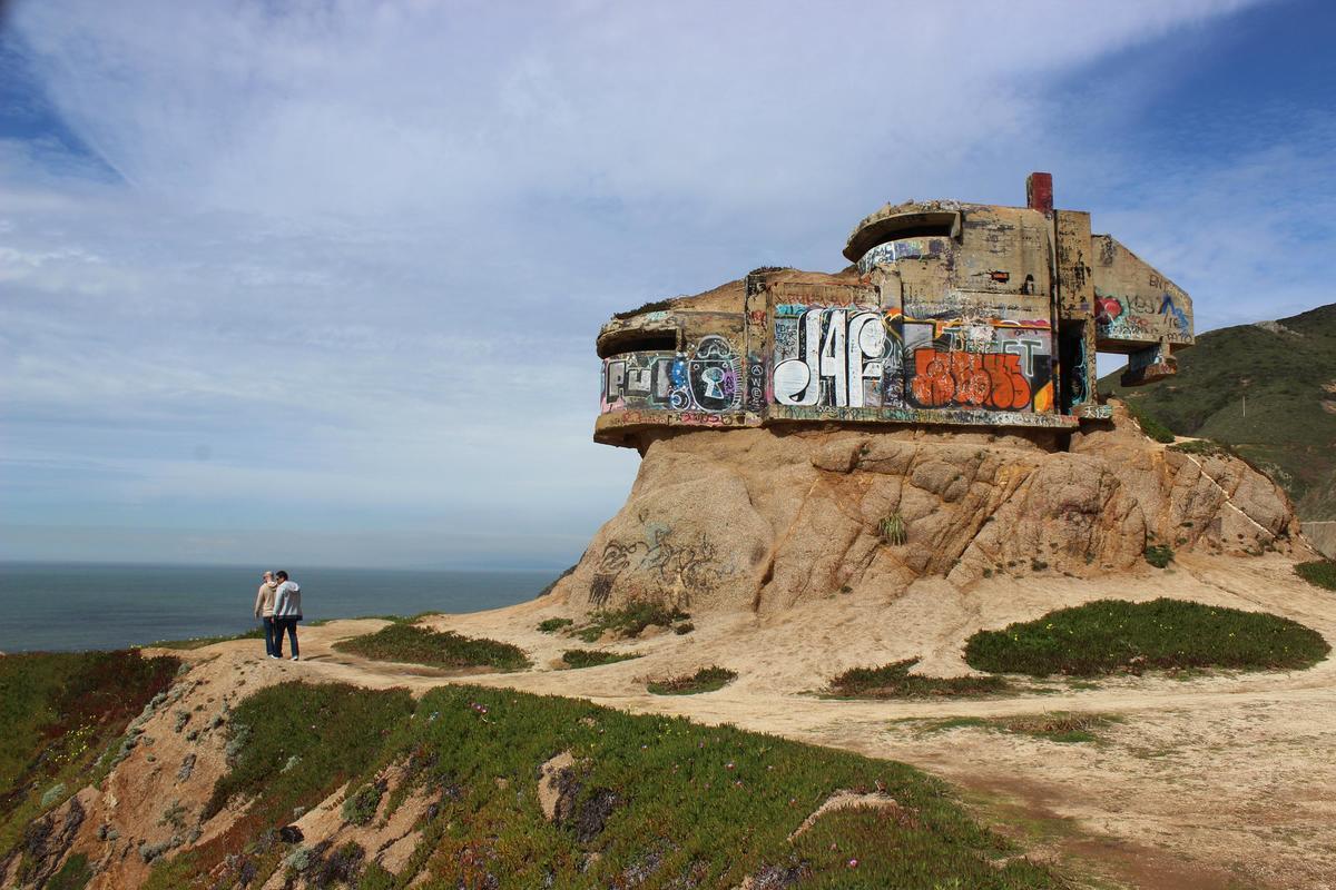 Tourists visit the abandoned bunker at Devil's Slide, CA.