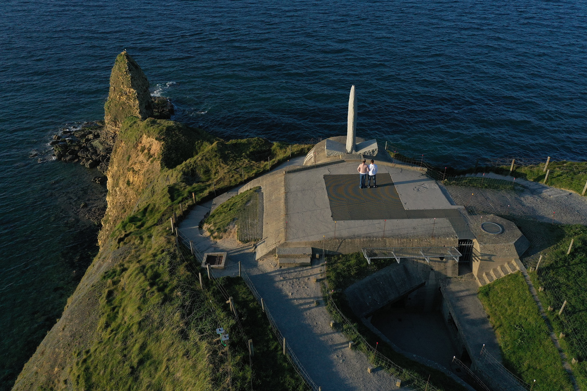 An aerial view shows visitors at Pointe du Hoc.