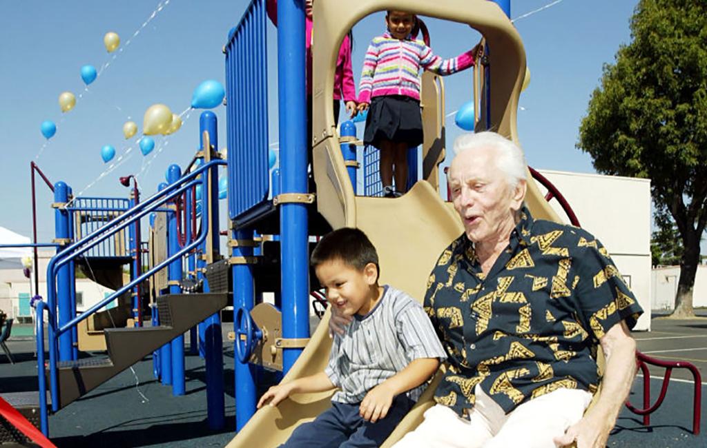 Kirk Douglas on a slide