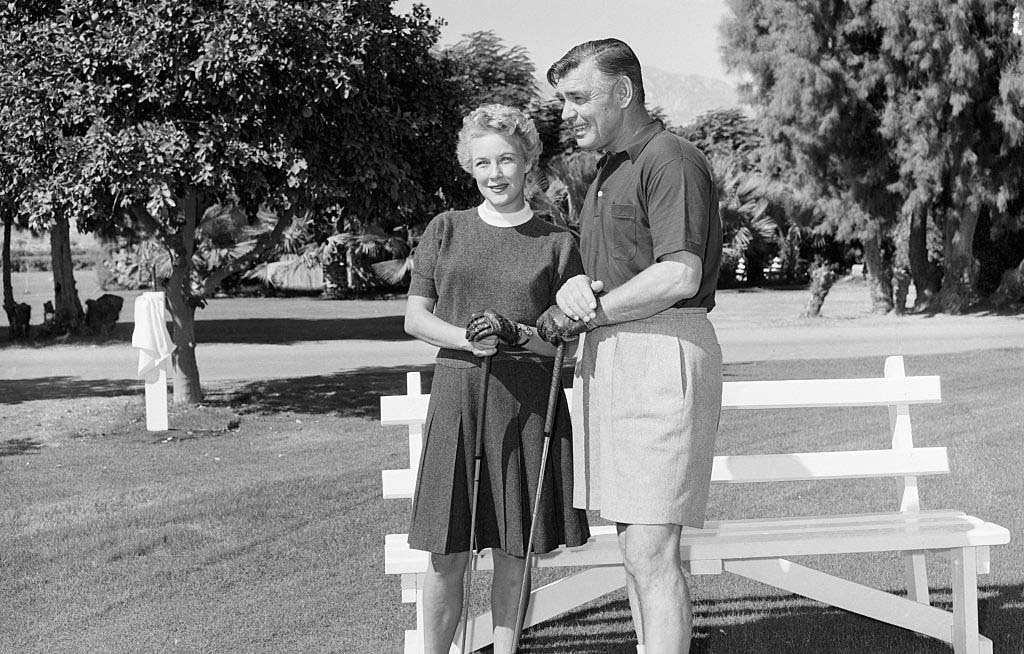 Gable and Spreckles playing golf