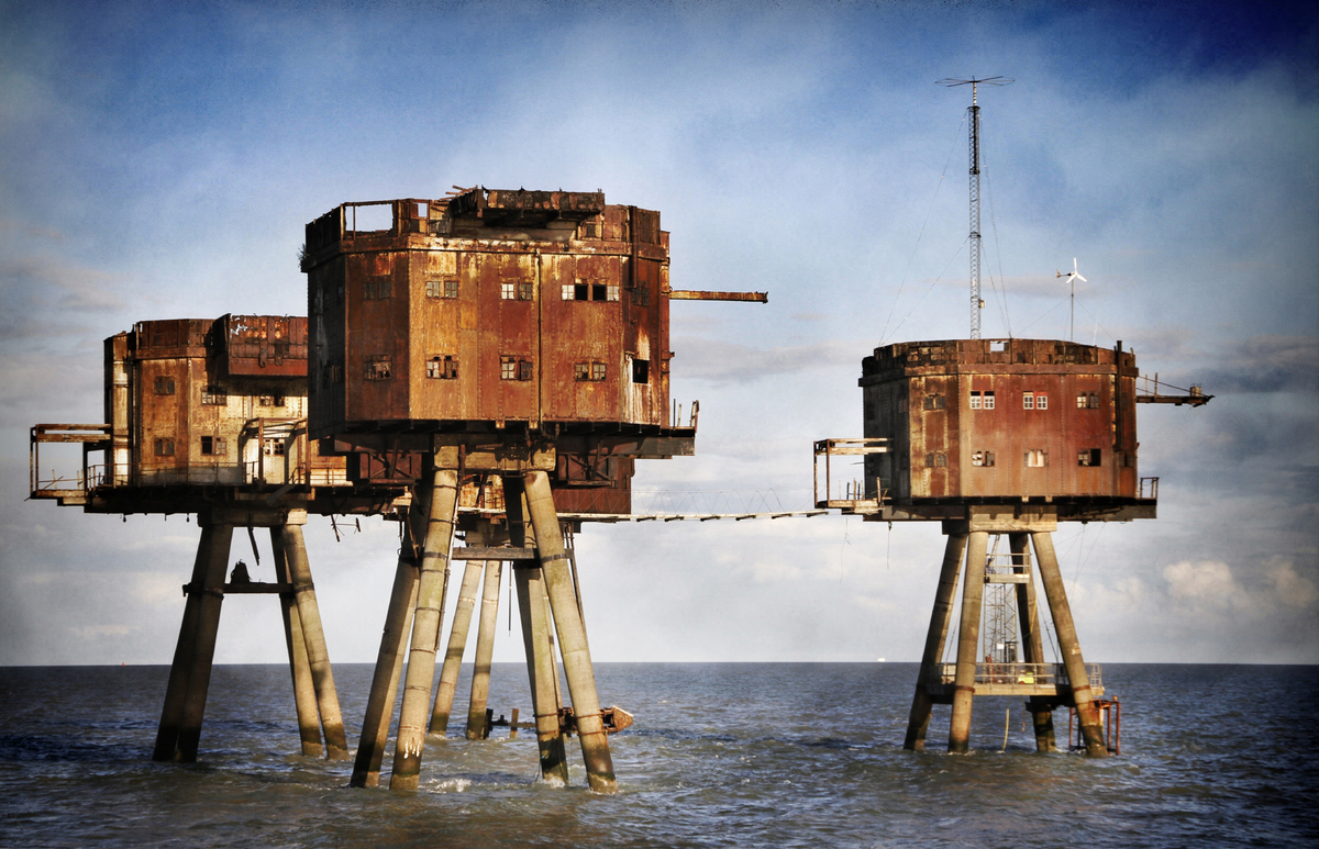 The sea Maunsell forts tower above the mouth of the river Thames.