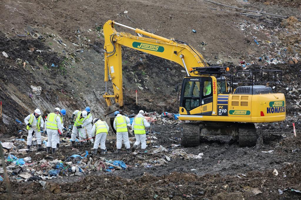 People searching through trash