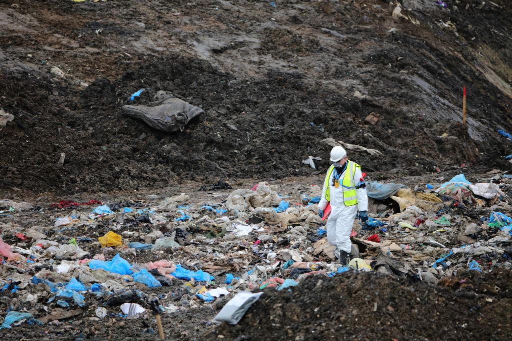 Man searching through trash