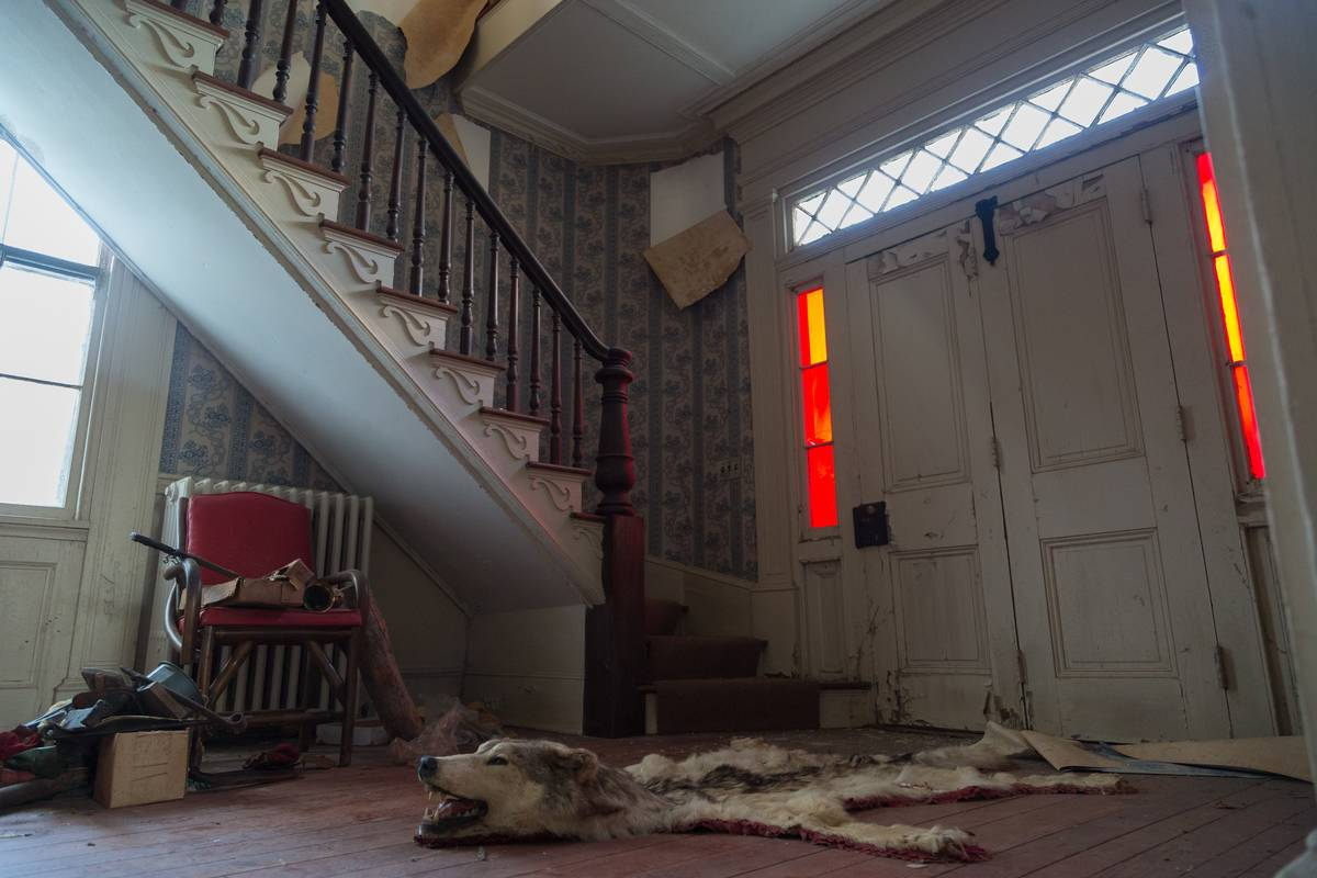The home's foyer is tattered and torn.