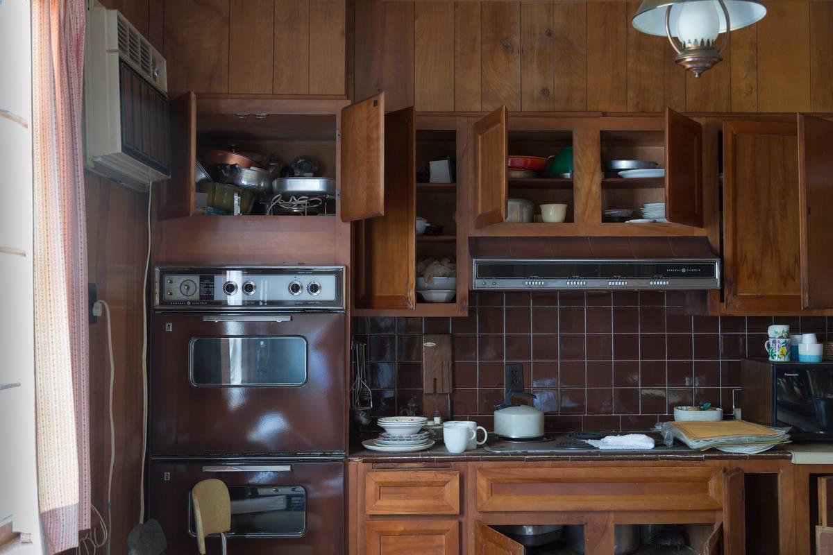 A wooden kitchen has retro appliances.