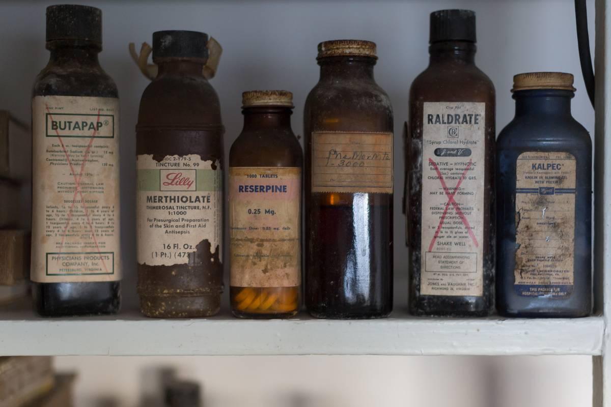 A closeup shows medicine bottles.