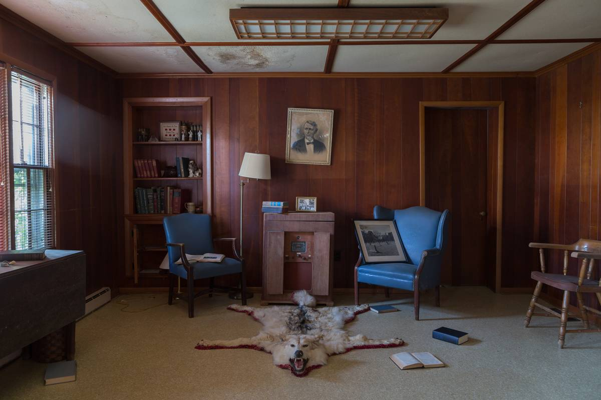 A wolf rug lies in a study.