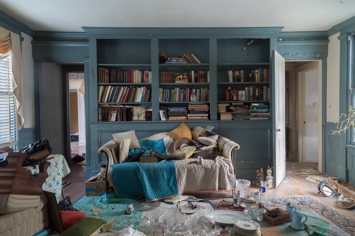 A living room is full of clutter.