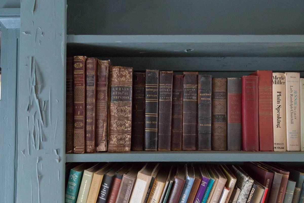 A closeup shows books on a shelf.