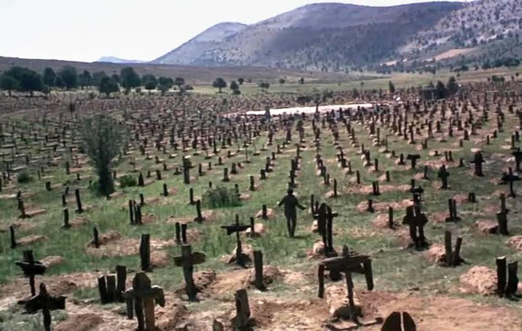 Wallach walking through a graveyard
