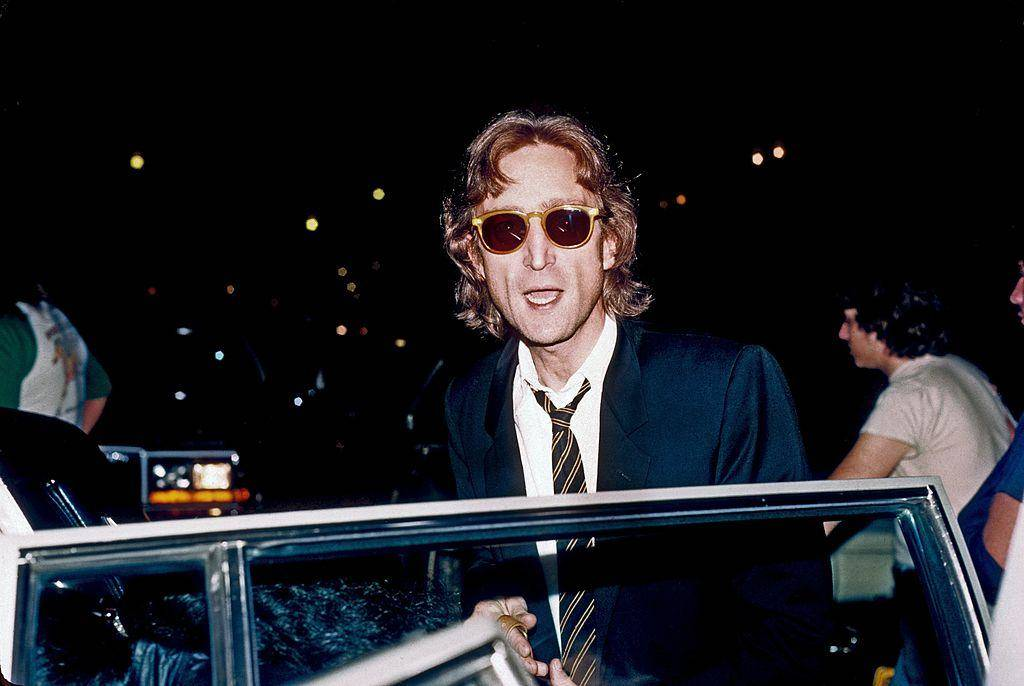 John Lennon getting into a car