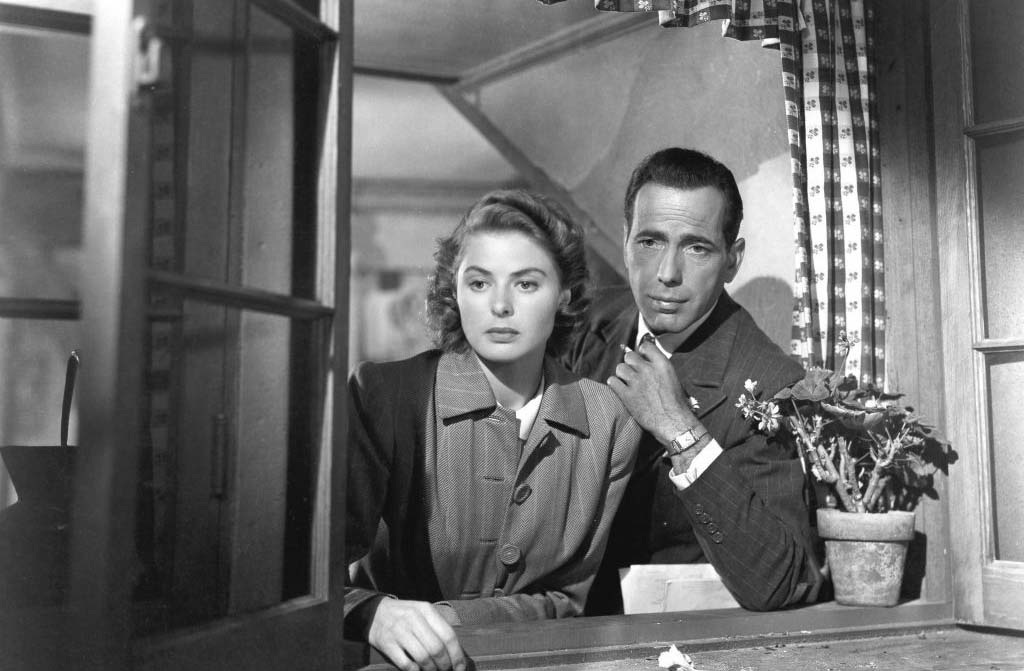 Ingrid Bergman and Humphrey Bogart looking out of window