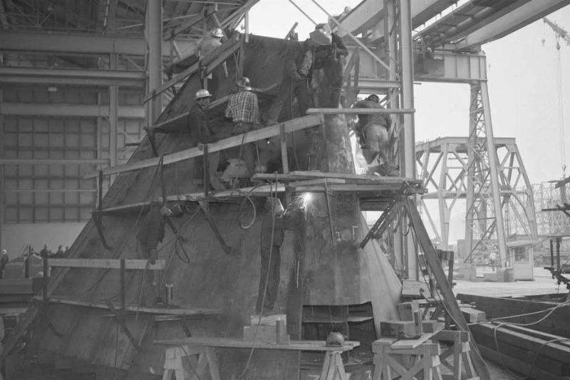 Men building a ship