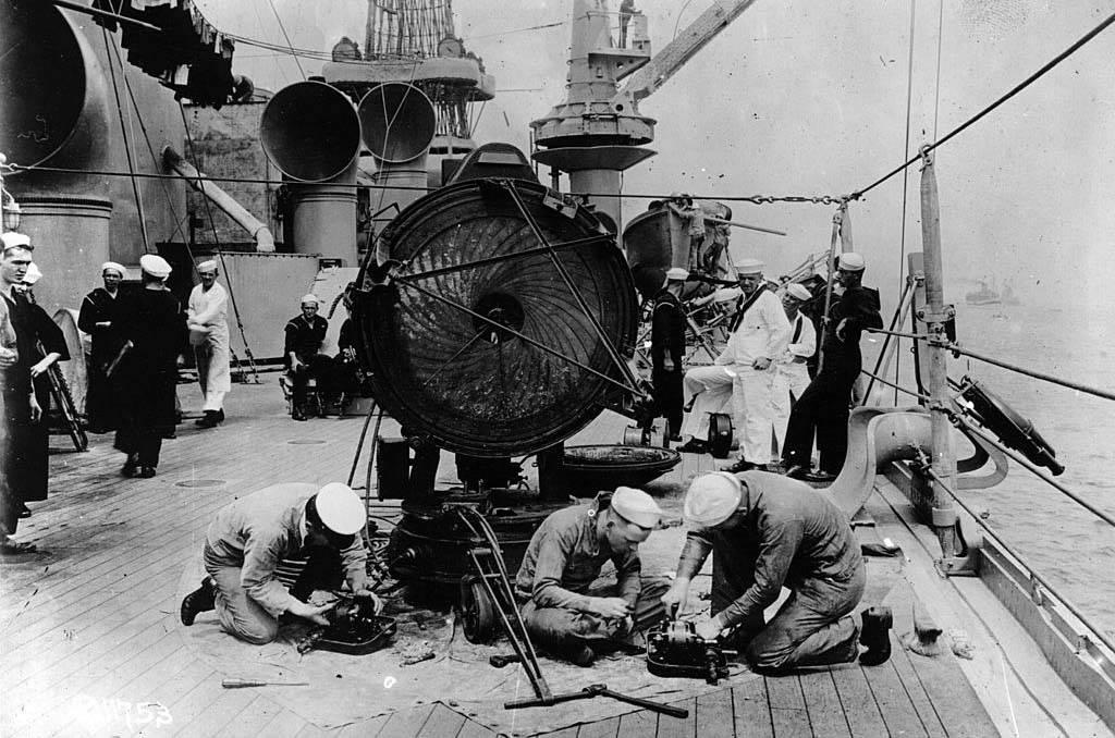 Men repairing ship