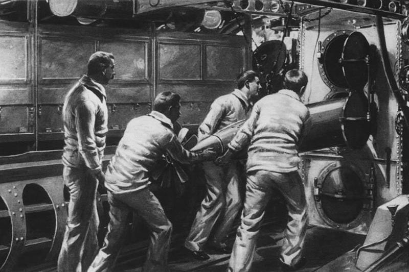 Men loading a torpedo