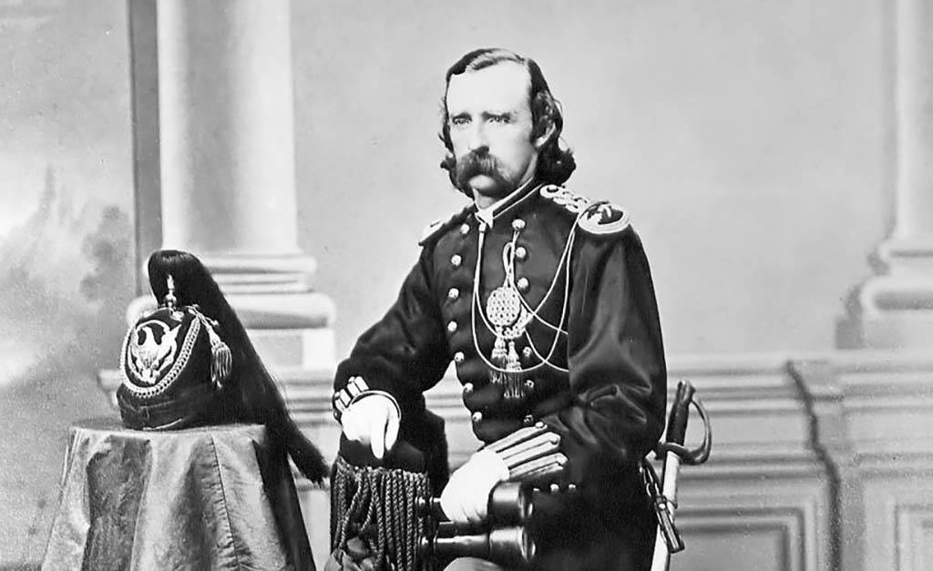 Custer sitting down