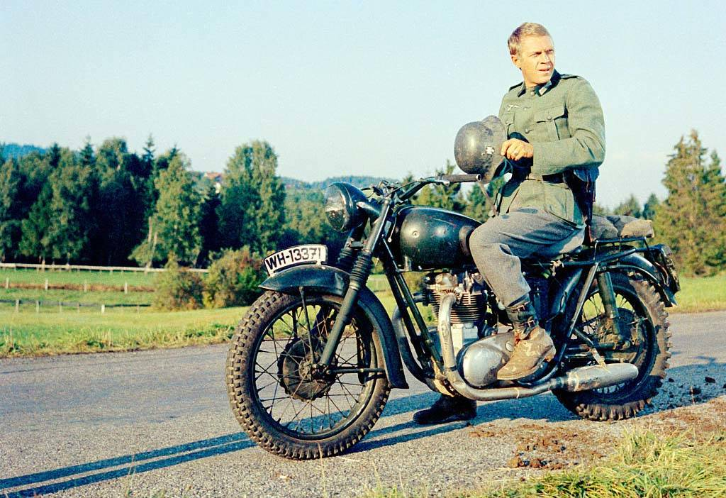 McQueen on a Triumph motorcycle